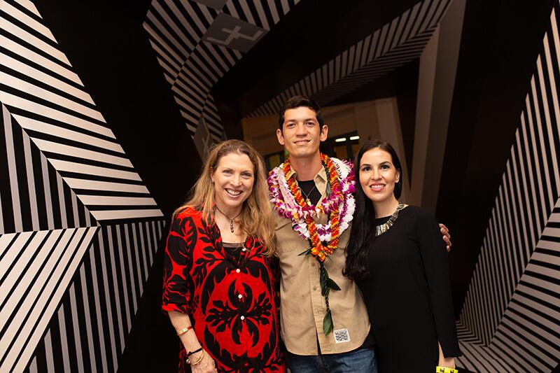 Native Hawaiian artist Cory Taum with art installation Laukanaka