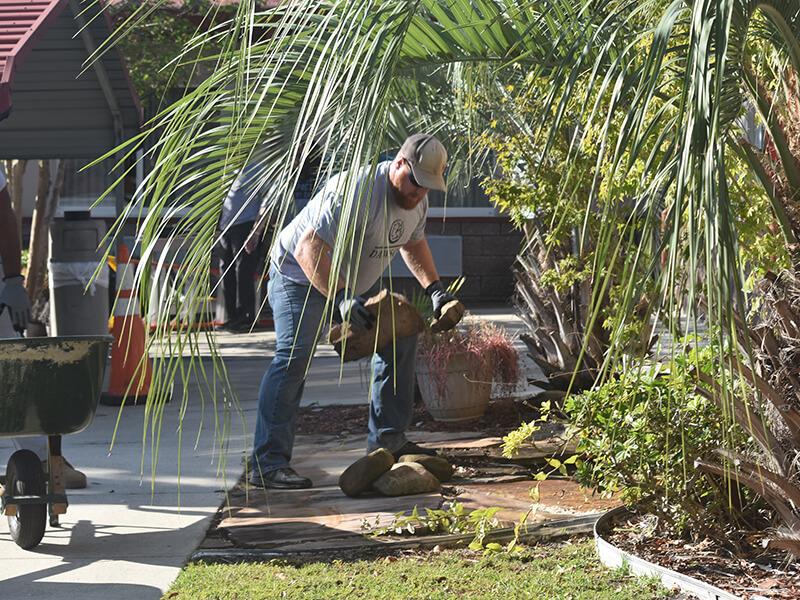 Man volunteering at Emerald Shores Health & Rehabilitation center